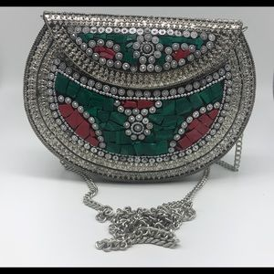Indian handmade metal clutch with mosaic stones